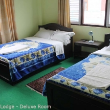Deluxe Room Bed View of New Pokhara Lodge Lakeside Pokhara Nepal.