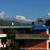 beautiful picture of Mountain and New Pokhara Lodge Building