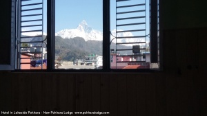 A beautiful mountain view seen from window of a hotel in a Lakeside Pokhara - New Pokhara Lodge